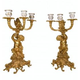 Пара бронзовых подсвечников с путти в стиле барокко